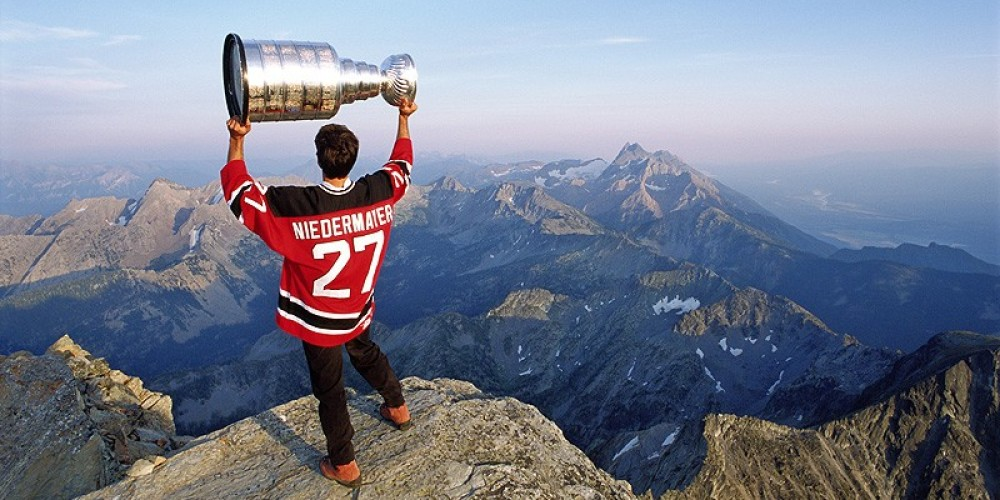 National Hockey League's local hero Scott Niedermayer used his champion's right to a day with the Stanley Cup and hoisted the trophy at the top of Fisher Peak. – Alan Maudie - www.alanmaudie.com