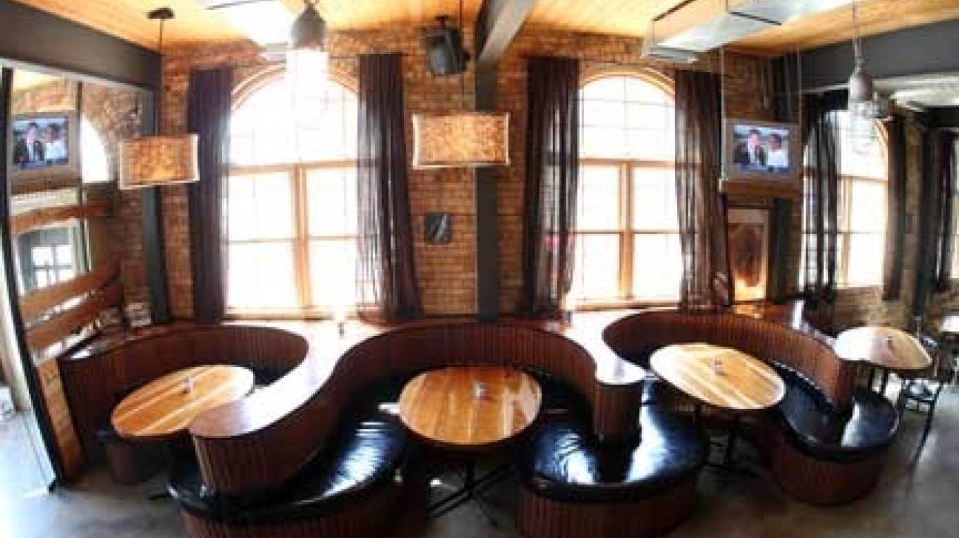 The Brickhouse features loungy s-shaped booths and windows that expose the original arch shape. – Mark Gallup