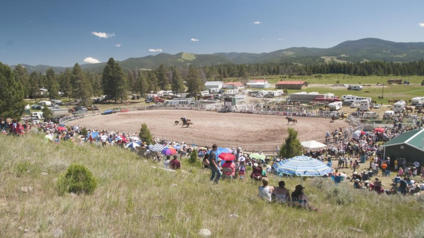 A great view of the rodeo actioncan be had on the hillside above the arena. – Roger M. Dey