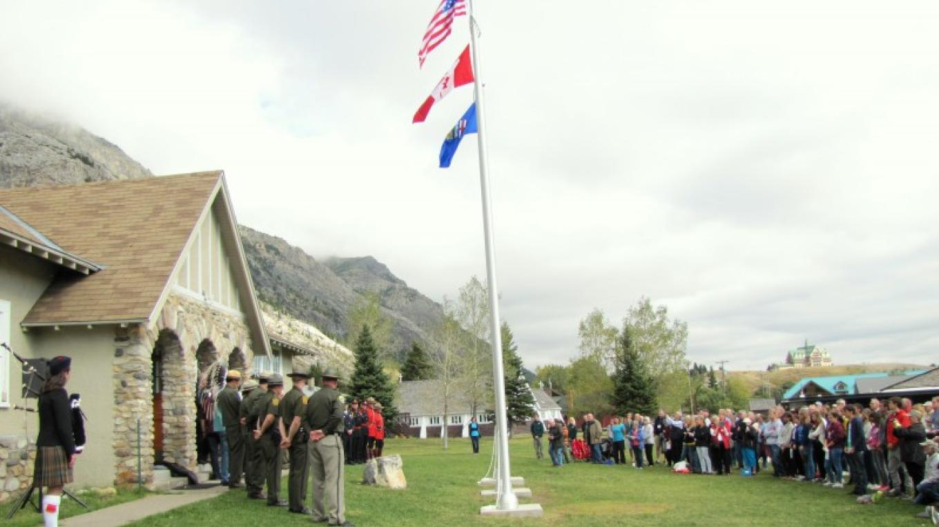 83rd Peace Park Assembly brought Rotarians and future Rotarians together for dedication of flag poles to the Waterton Community Association and the annual ceremonial Hands Across Borders Pledge. – Sheena Pate