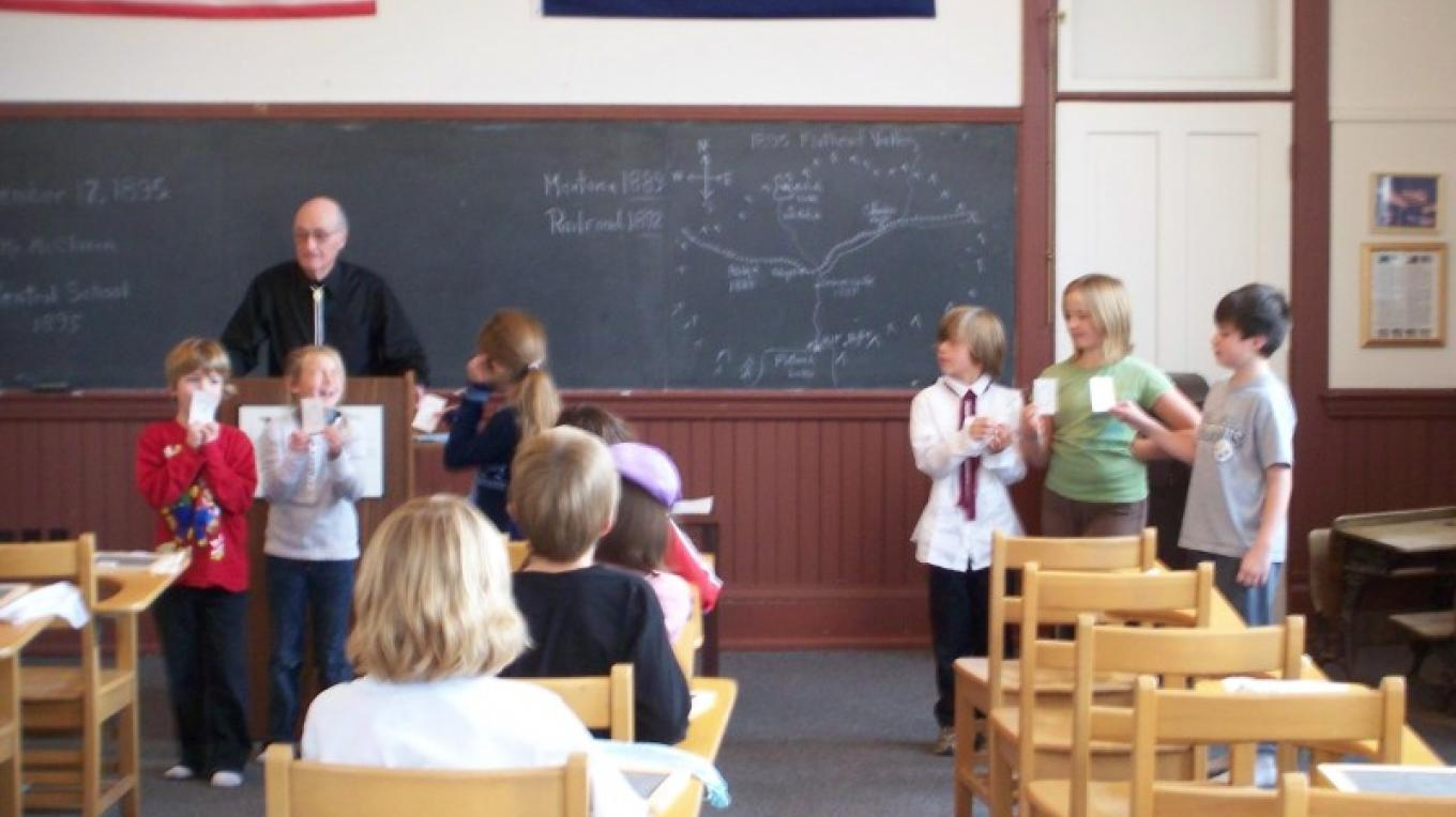 Volunteer teachers in our 1895 Classroom Experience help local 3rd graders understand what school was like over 100 years ago in our building. – Bruce Ruby