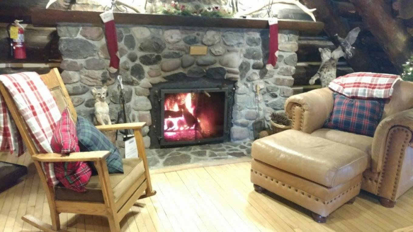 Original stone fireplace in full working order! – Historic Tamarack Lodge and Cabins