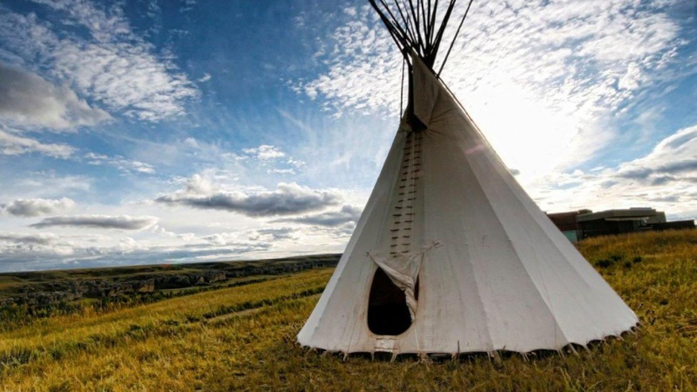 Blackfoot tipi on prairie grassland in Writing-on-Stone Provincial Park / Áísínai'pi National Historic Site – J. Novotny, Alberta Parks