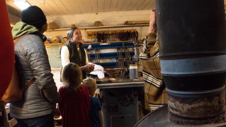 Martha Swanson demonstrating fine woodworking skills at the couples SwanWoods studio, near Ovando, MT. – Sheena Pate