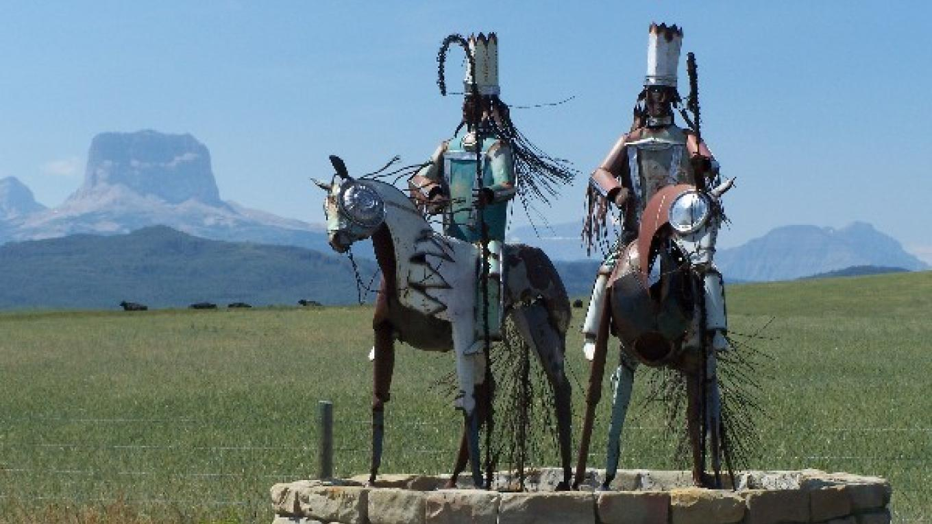 Metal Warrior sculpture in the north is located near the US-Canadian border on Highway 89 – Blackfeet Environmental Office