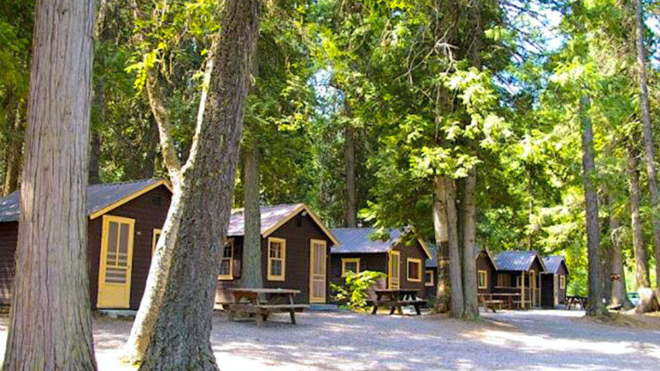 Apgar Village Cabins nestled along McDonald Creek. – Glacier Park Inc