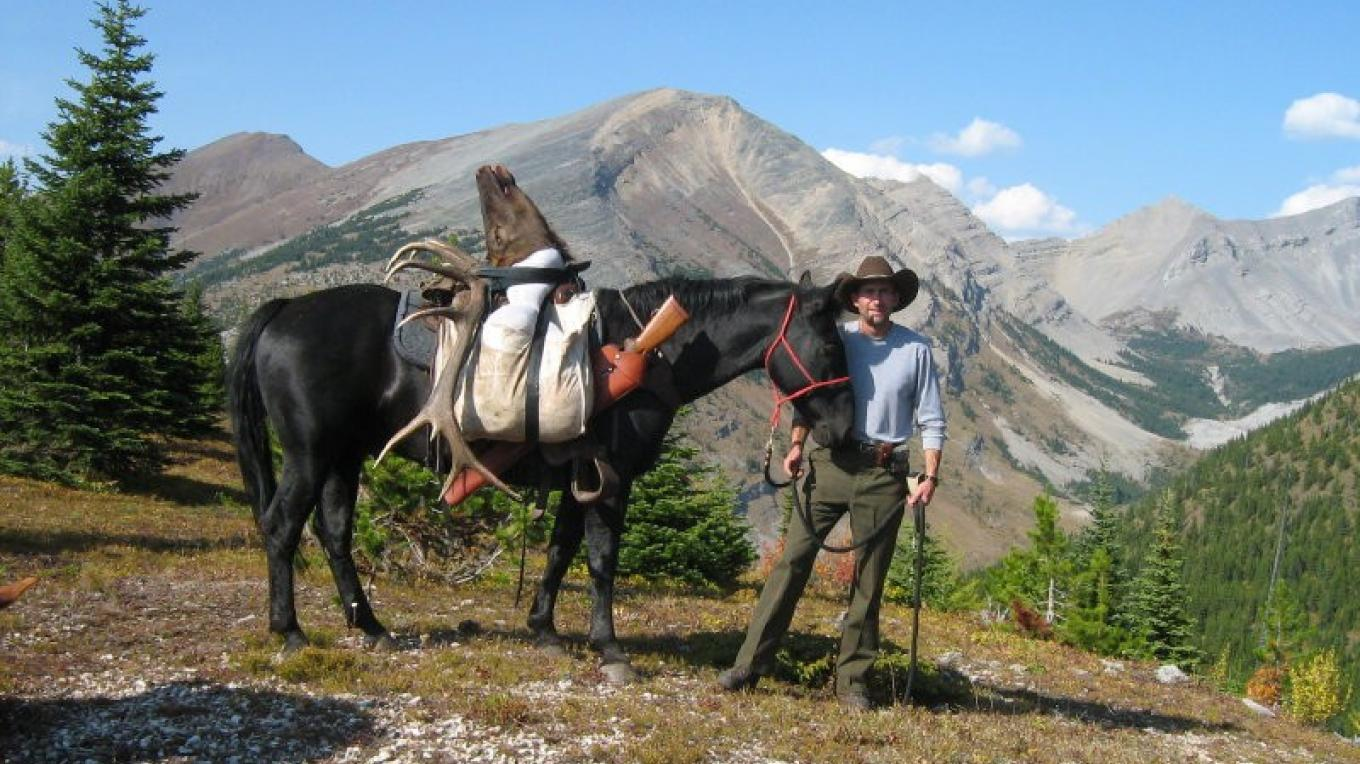 BHA member Bill Hanlon, a resident of Elkford, British Columbia, celebrates the holy trinity of backcountry hunting: Wild Country, Good Horses, Big Bulls – Countesy of Bill Hanlon
