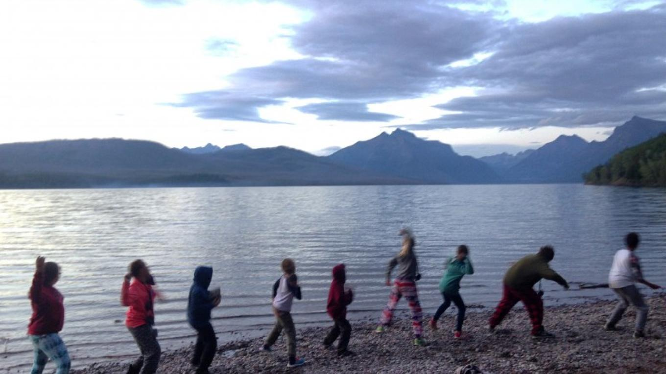 Students skip rocks at iconic Lake McDonald