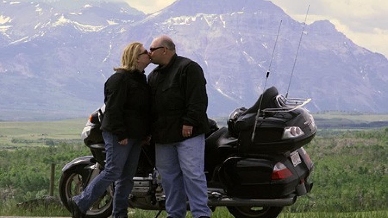 Gina and Jason Davis honeymoon by motorcycle near Waterton Lakes Park. – David Thomas