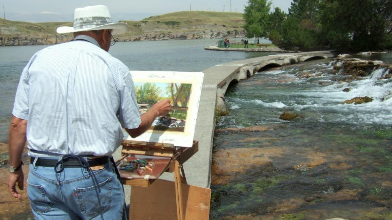 Steve Nelson capturing Giant Springs State Park with the stroke of his paint brush. – Gayle Fisher