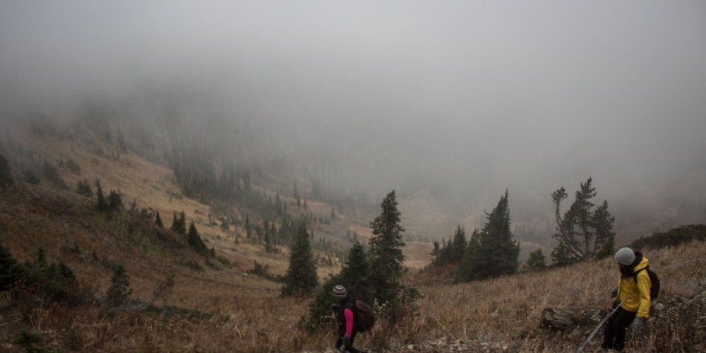 Descent on Peters Ridge Trail back to trailhead. Beneath the clouds is the Flathead Valley looking northwest. – Sheena Pate