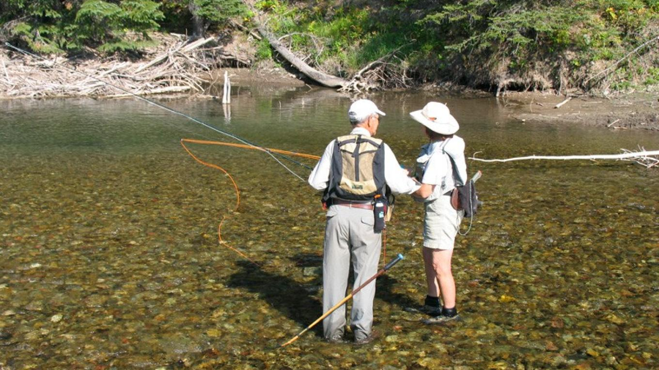 Big trout are easy to see, and hard to catch when they congregate in deep pools in late summer on West Castle River. – David Thomas