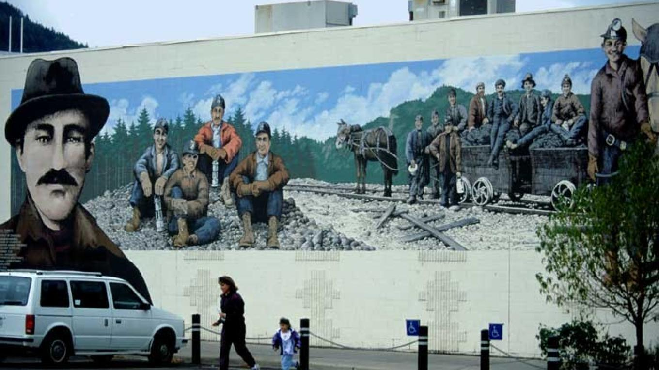 Downtown murals depict local historic themes. – Don Weixl