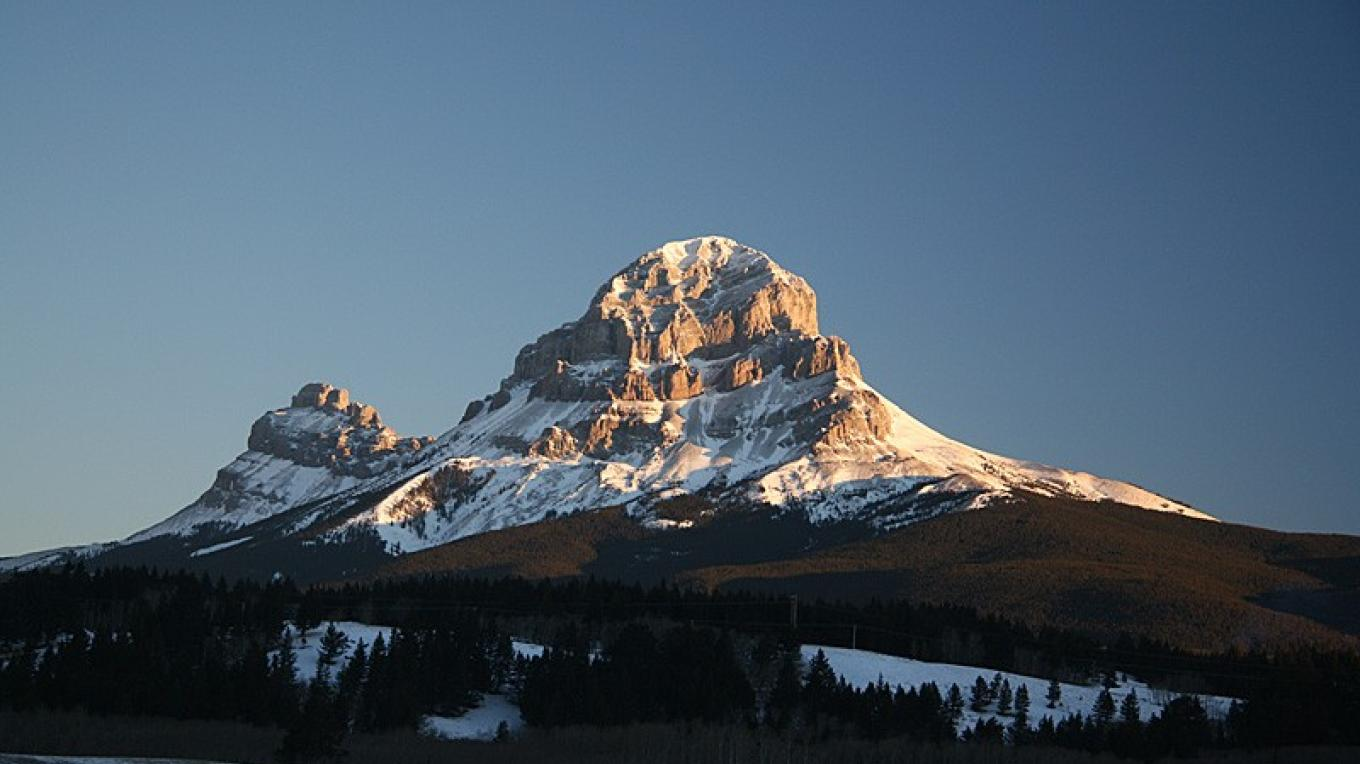 Crowsnest Mountain in Winter. Allison Creek cross-country ski area is west of mountain. – David Thomas