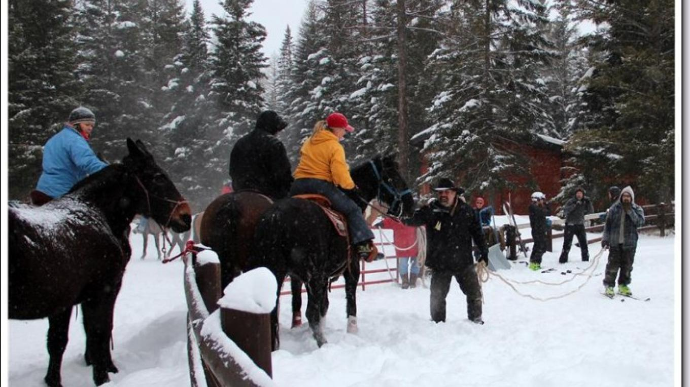 2015 Ski Joring Practice- Scott Ping, Event Organizer, talking course logistics with riders and skiers. – Marguerite Amstadt