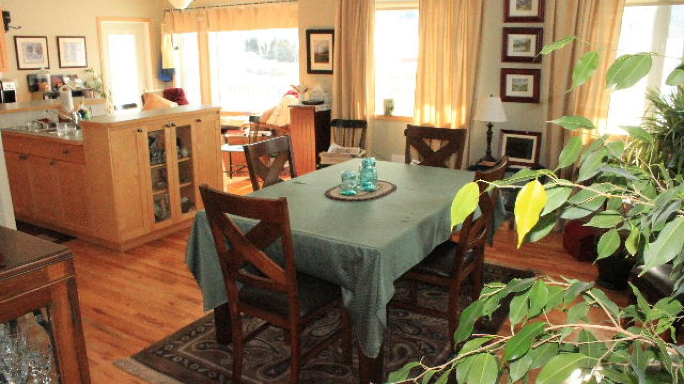 Dining area upstairs - plenty of room to visit with lots of windows – Deb Webster