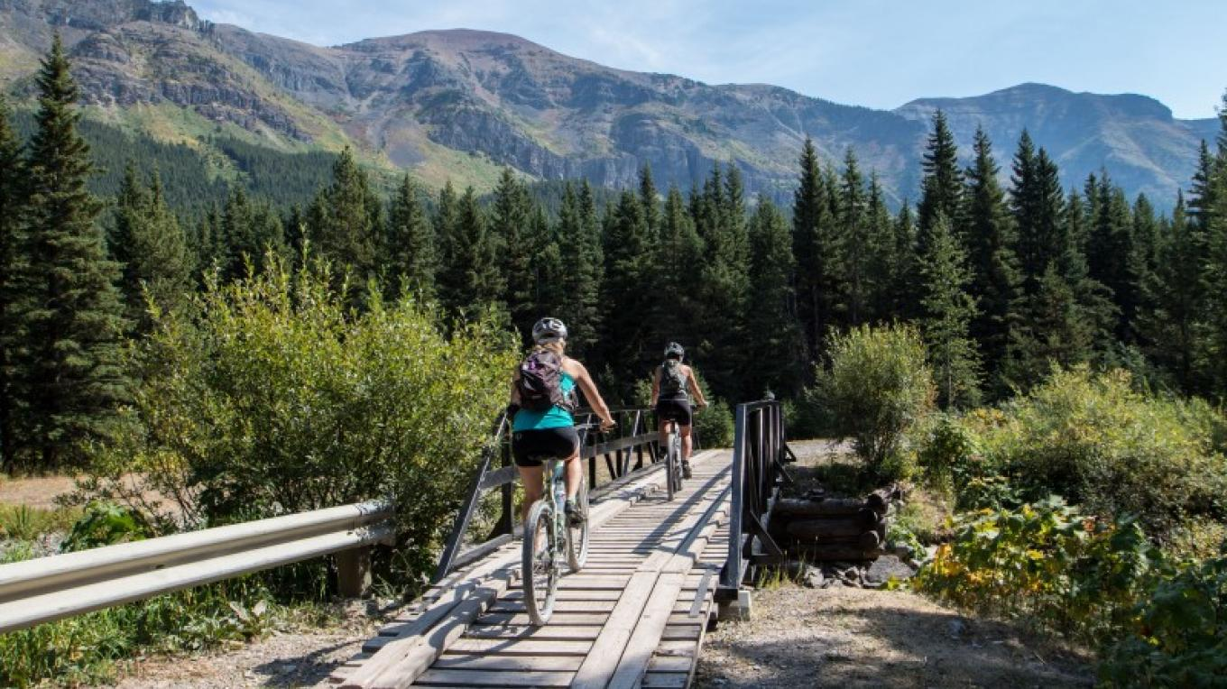 Mountain biking along West Castle River. – Sheena Pate