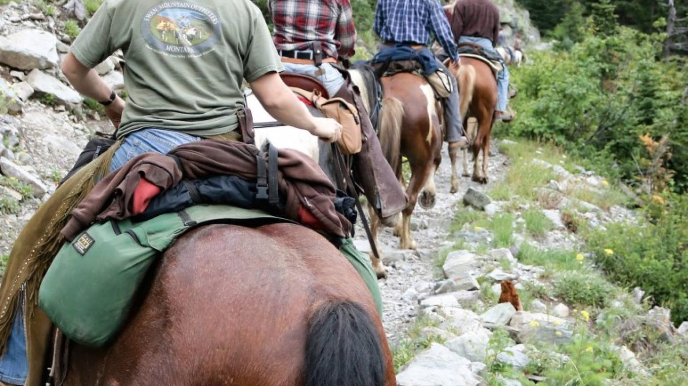 Wranglers riding Sperry Trail – Swan Mountain Outfitters