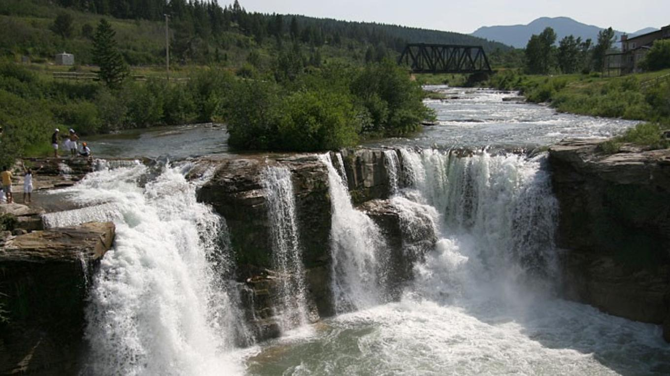Near campground, Crowsnest River spills over Lundbreck Falls – David Thomas
