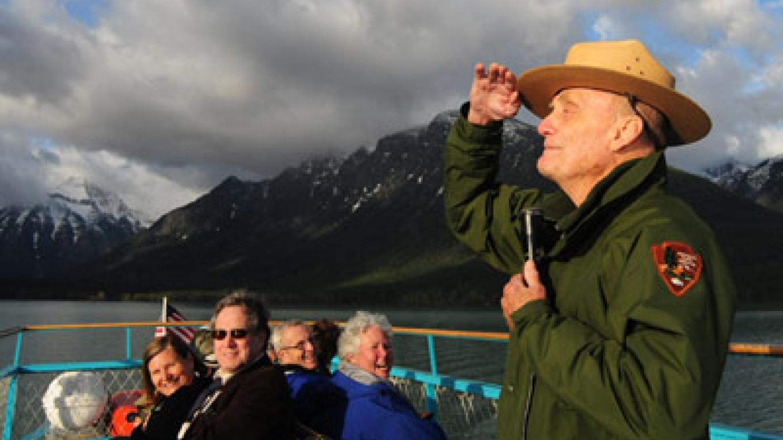 Ranger Doug Follett shares Glacier stories with park visitors on Lake McDonald – Chris Peterson