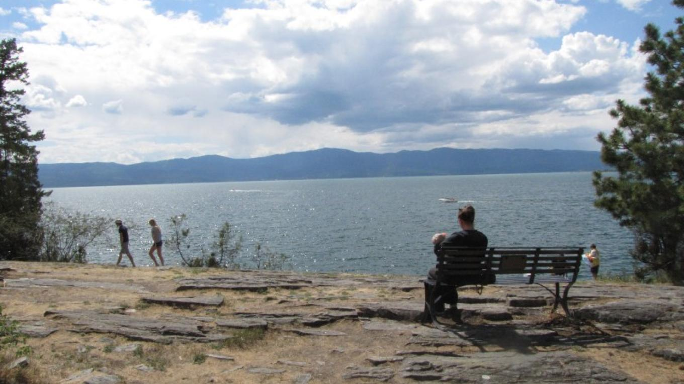 Rocky cliffs along shoreline offer spectacular views of Flathead Lake. – S. Pate