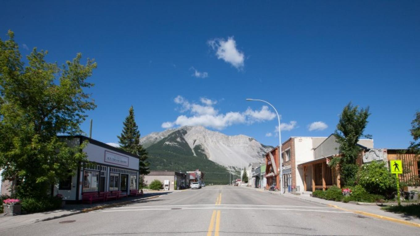 Impressive mountain views from downtown Bellevue, Alberta and the Old Dairy Ice Cream Shoppe, on Crowsnest Pass. – Sheena Pate