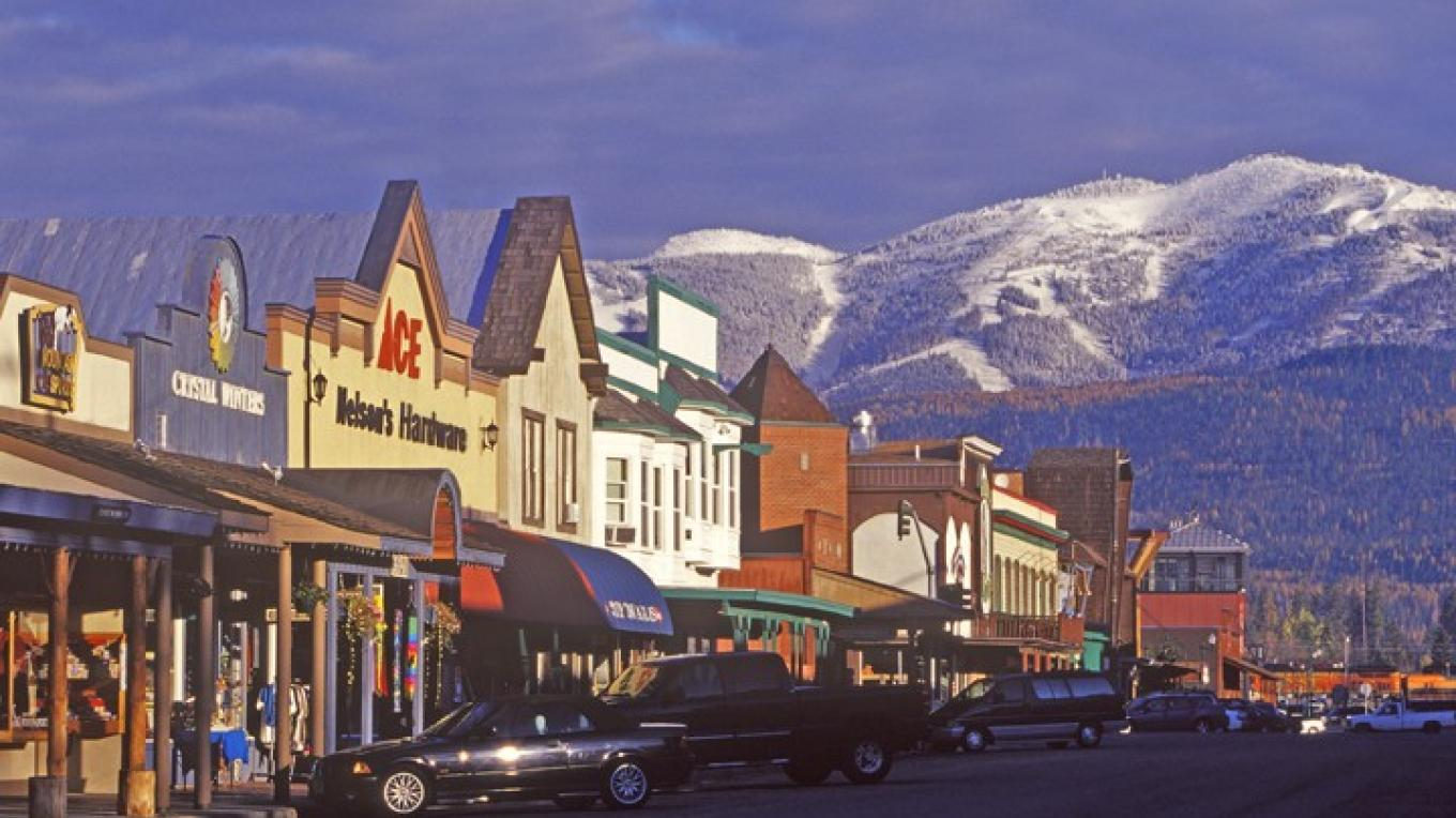 Downtown Whitefish in the autumn as first snow dusts the mountains that rise from the edge of town. – Chuck Haney
