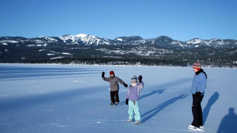 Bliss = skating under blue skies on Whitefish Lake – John Frandsen
