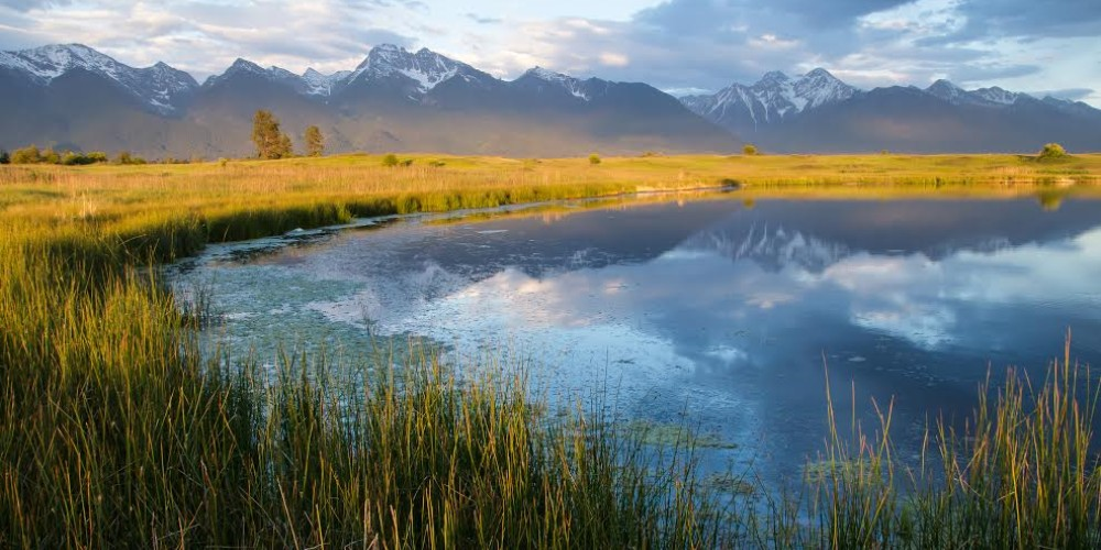 Mission Mountains seen from Kicking Horse Waterfowl Production Area, near Ronan, Montana – Adam Birely