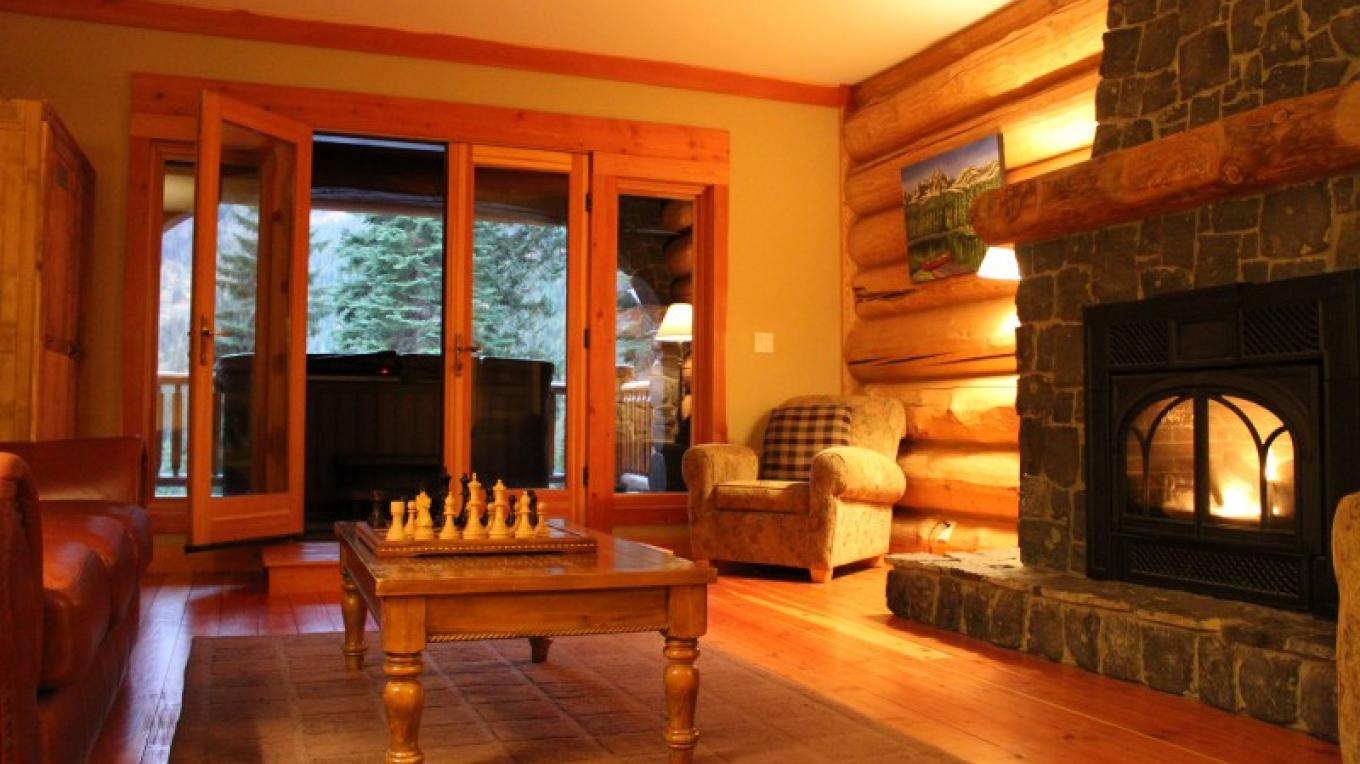 Cedar Lodge common room opens to deck with hot tub and spectacular mountain views. – Sheena Pate