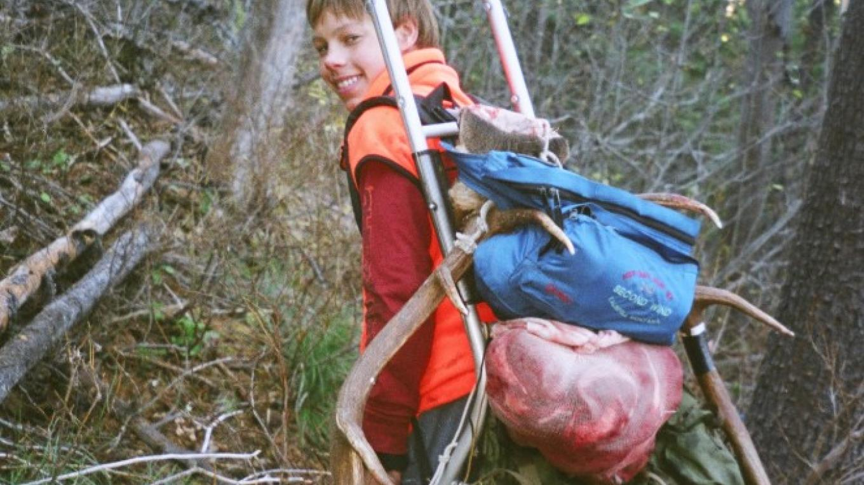 Kalispell teenager Jeremiah Gaiser packs out an elk in northwestern Montana. – Ben Long