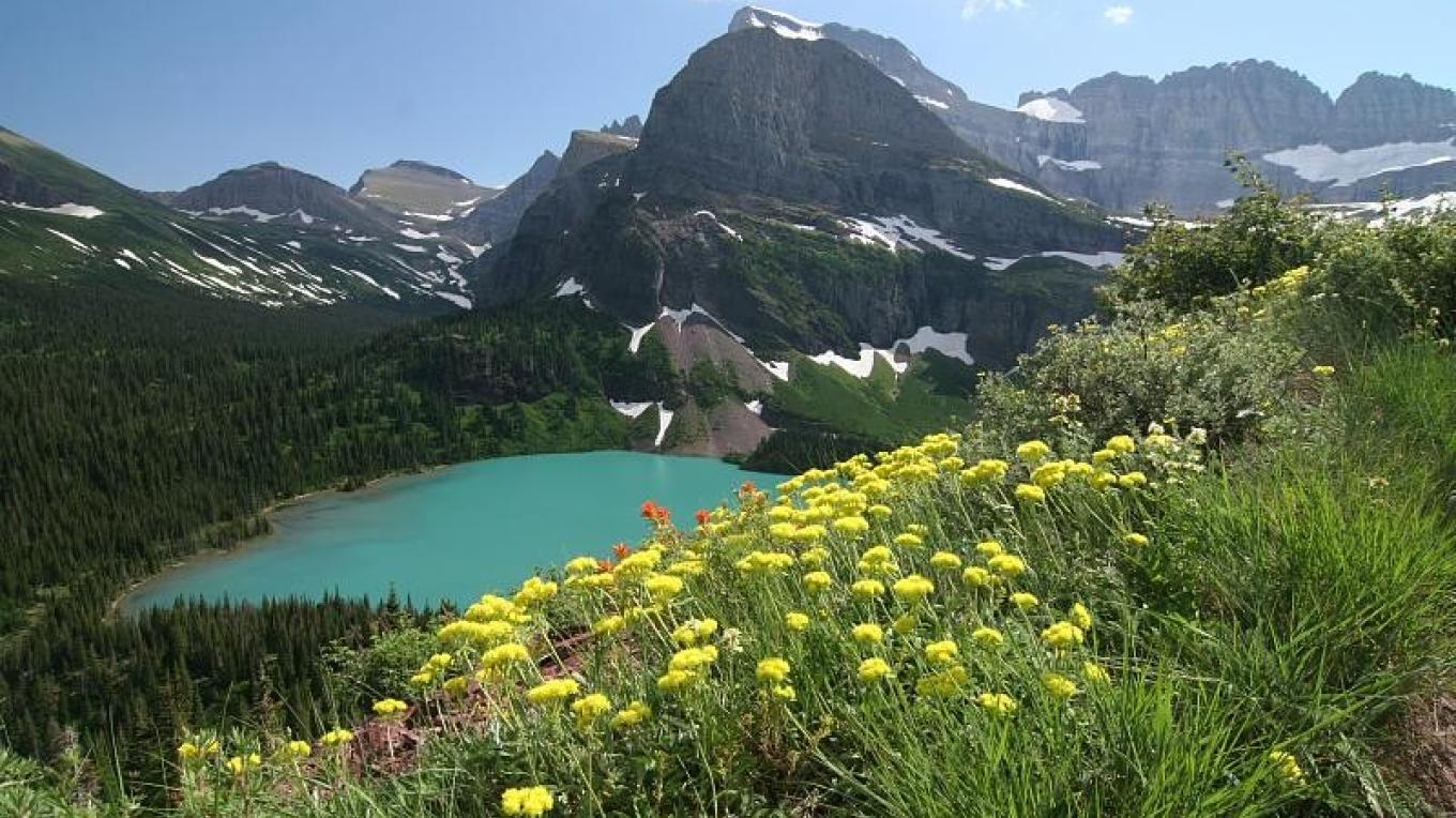 Wildflowers, pristine lakes, and jaw-dropping mountain scenery define Waterton-Glacier International Peace Park. – Simon Williams