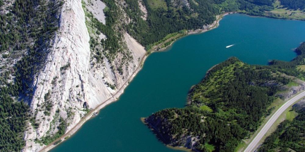 The sheer cliff face of Crowsnest Ridge dominates Crowsnest Lake. – David Thomas