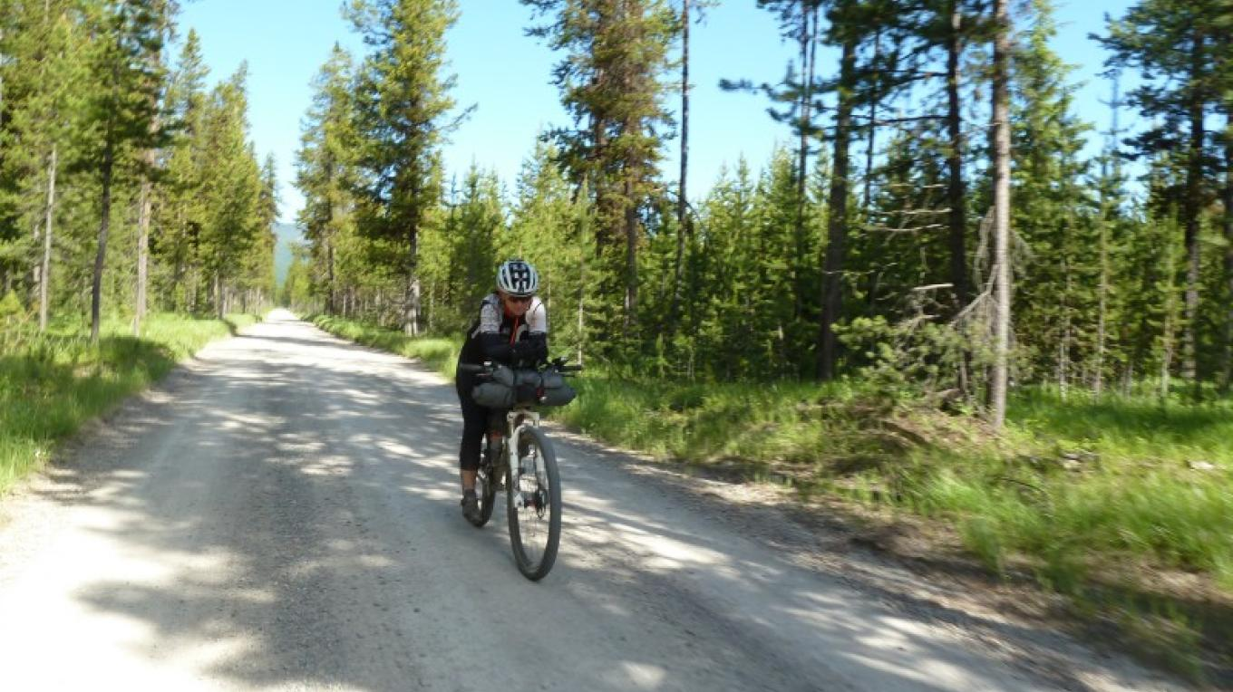 Rider Heading Up Red Meadows Pass Outside Of Whitefish, MT – Cricket Butler