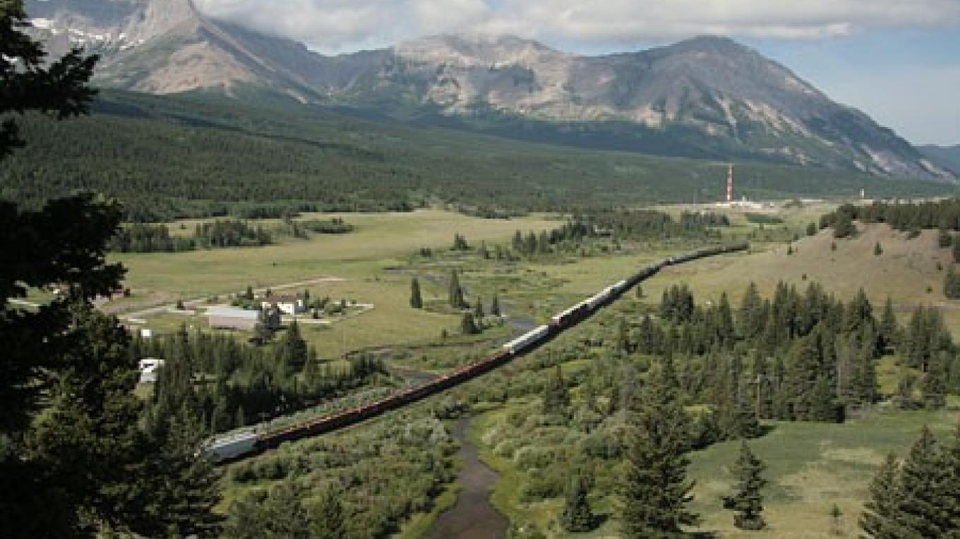 Westbound freight grinds uphill towards Contintental Divide at Crowsnest Pass. – David Thomas