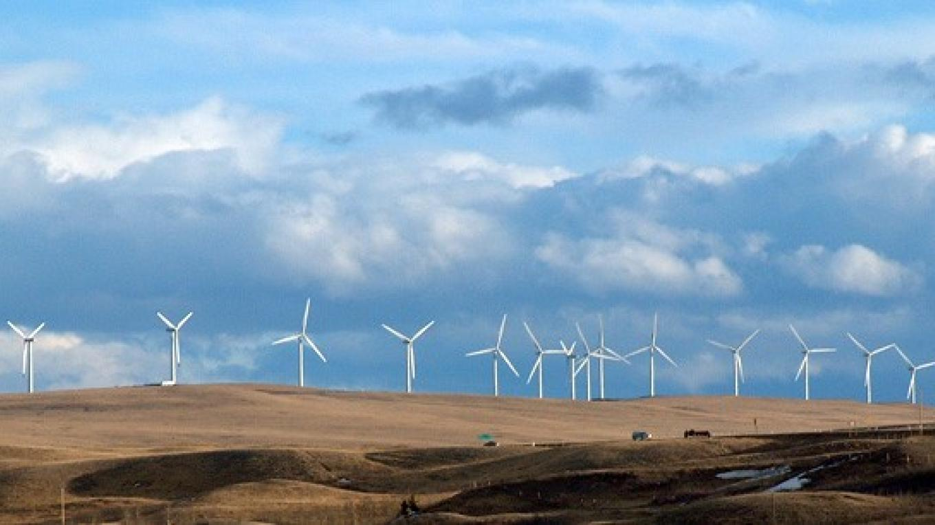 Cowley Ridge is topped by a thin green line of wind mills. – David Thomas