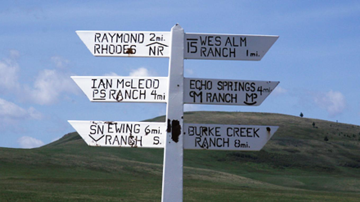 Brands point the way to the few large spreads of Porcupine Hills ranch country. – David Thomas