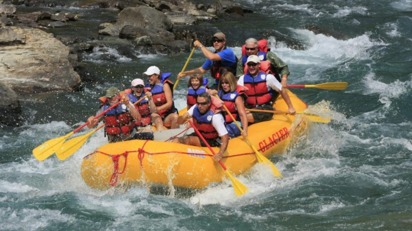 Whitewater rafting on the Middle Fork of the Flathead River near to Glacier National Park with Glacier Raft Company. – Courtesy Glacier Raft Company