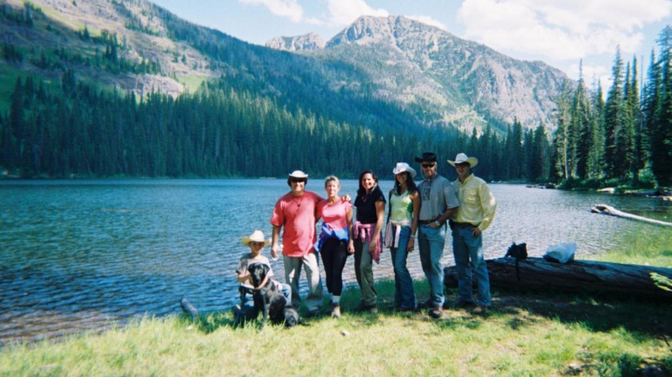 A family enjoys an epic Montana day at Palisades Lake in the Bob – Swan Mountain Outfitters