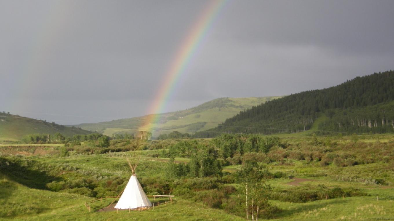 Rainbow highlights the tepee - a pot of gold? – Debbie Webster