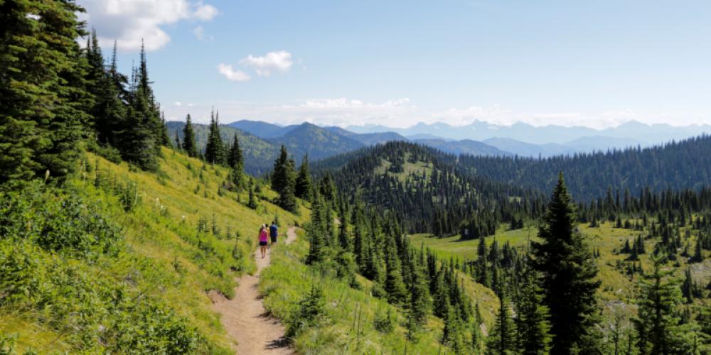 Danny On Trail with views of Glacier National Park to the east. – Mike Beall