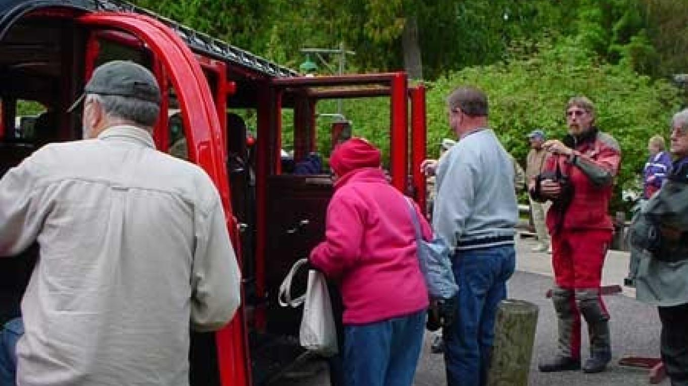 Park guests prepare for a Red Bus adventure – Hillary Smith