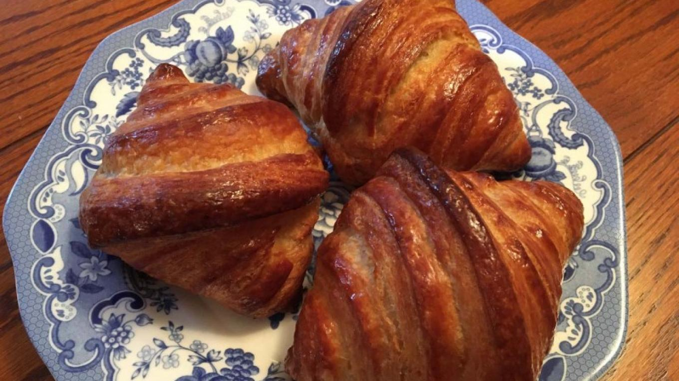 Plate of freshly baked croissants. – Dave and Chris Handley
