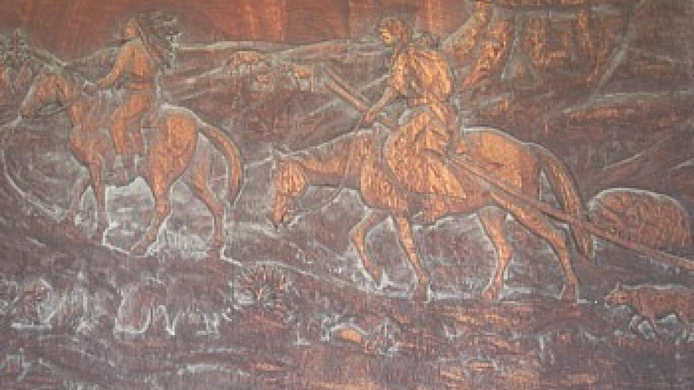 One of two carved wood panels at the entrance by the noted Blackfeet sculptor, John L. Clarke – Colleen's Computer Corner, LLC