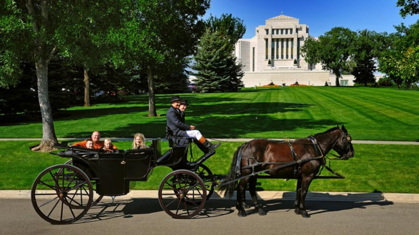 A carriage in front of the Mormon Temple on Alberta's Mormon Trail. – Star Media Services