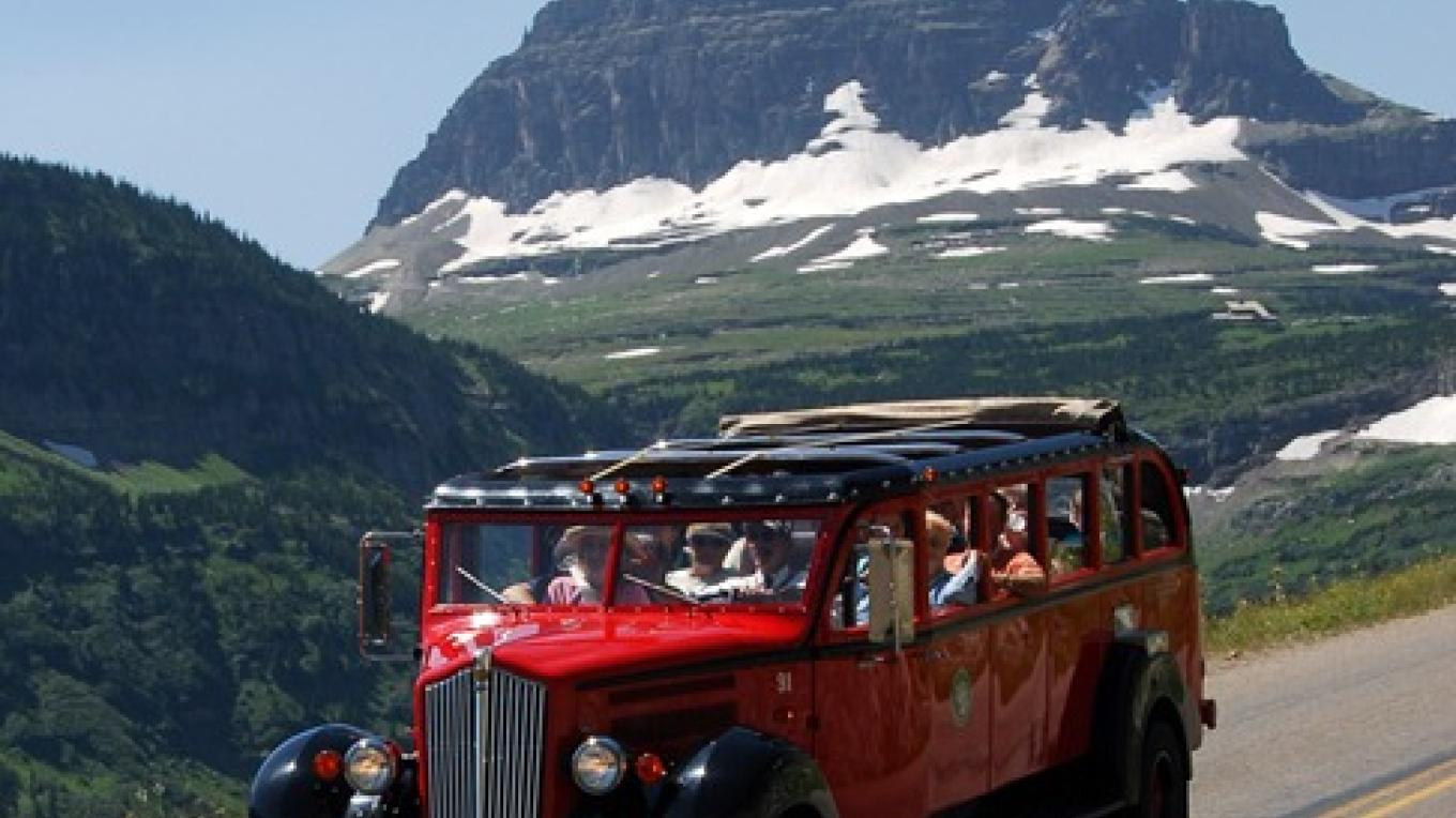 Enjoy a learning vacation while helping protect the environment on a red jammer bus in Waterton-Glacier International Peace Park. – Donnie Sexton