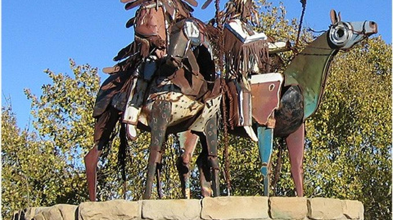 An up close view of the Metal Warrior sculpture located just outside of  East Glacier Park on Highway 2 – Colleen's Computer Corner, LLC
