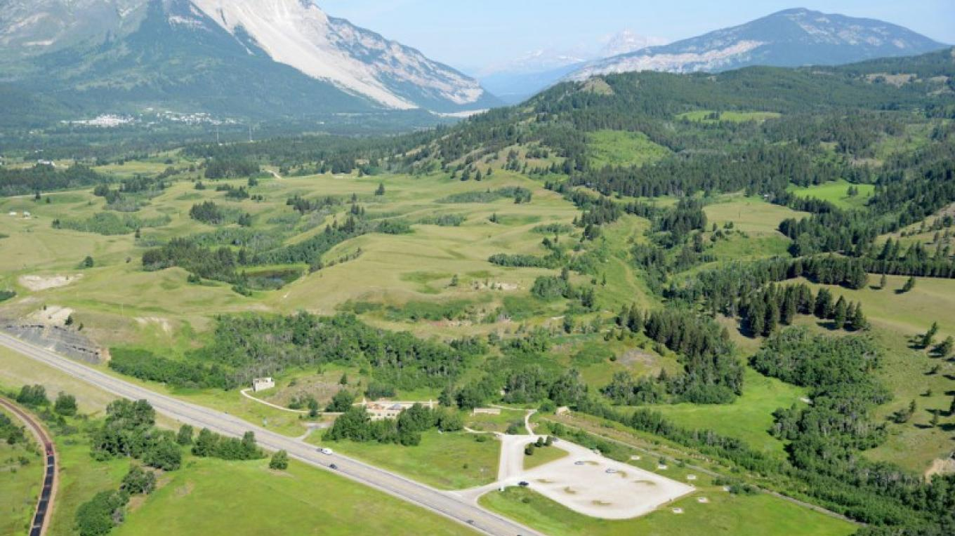 Leitch Collieries, far right, is located on Highway 3 approach to Crowsnest Pass. Turtle Mountain and Frank Slide are in the background. – Courtesy Frank Slide Interpretive Centre