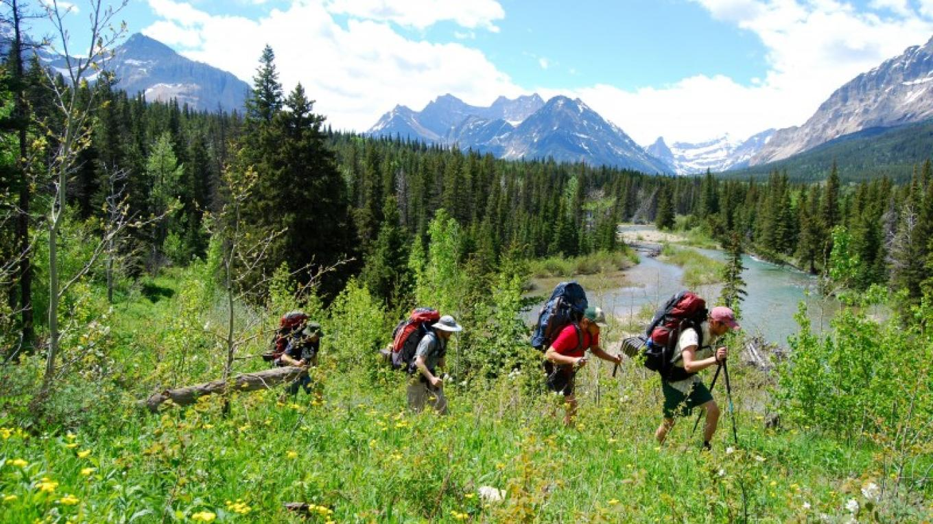 Hiking along Belly River with Glacier Guides. – Courtesy Glacier Guides