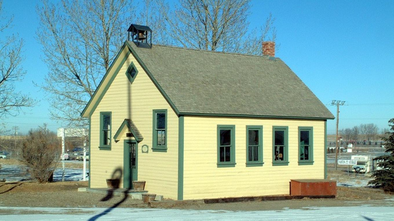 Restored 1906 schoolhouse serves as seasonal visitor information centre for Town of Nanton. – David Thomas
